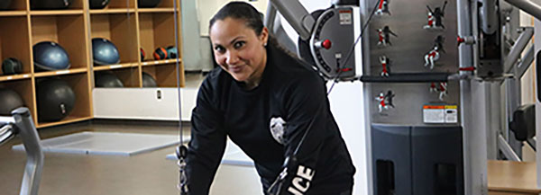 Police Officer Using Workout Machine