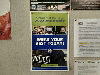 Wear your vest today poster on bulletin board